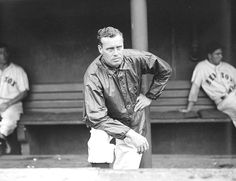 Boston Red Sox pitcher Wes Ferrell (in a windbreaker) on the dugout steps at Fenway Park.  Approx. 1935