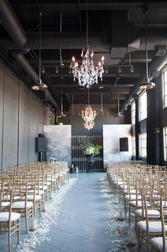 elegant industrial ceremony space, photo by Jarusha Brown http://ruffledblog.com/black-gold-calgary-wedding #wedding #ceremony #industrial