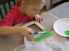 Kids paint their own frame. Or buy larger frame and put one of their own 'masterpieces' in for parents