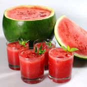 Watermelon punch - 1 seedless watermelon (flat on one side) 1 cup pineapple juice 1 cup mineral water fresh mint