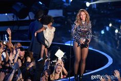 Recording artist Jay-Z (L) and daughter Blue Ivy Carter (C) present the Michael Jackson Video Vanguard Award to honoree Beyonce (R) onstage during the 2014 MTV Video Music Awards at The Forum on August 24, 2014 in Inglewood, California.  (Photo by Michael Buckner/Getty Images)