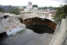 A sinkhole occurs when an area of ground collapses, creating holes that can swallow up swimming pools, roads, buildings and people.     The United States Geological Survey describes three different categories of sinkholes based on how they are created: dissolution, cover-subsidence and cover-collapse sinkholes.    In all three, erosion of land is caused by minerals washed away by water over time.    The most dangerous type of sink hole, and the ones we usually see in the news, are cover-collapse
