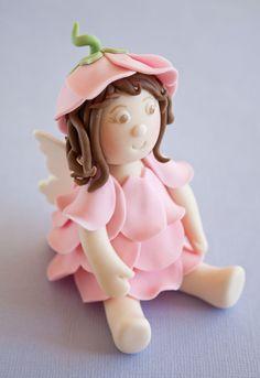 How to make a flower fairy cake topper on http://cakejournal.com/tutorials/how-to-make-a-flower-fairy-cake-topper/
