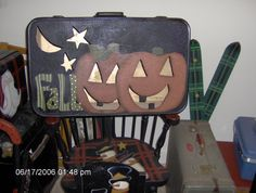 These are those old Samonsonite suitcase that we cut out painted and put a light in for a proch sitter Judy Currie