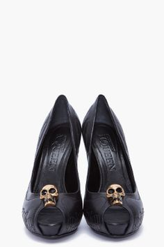 LOVE McQUEEN. open toe black pumps with gold skull and a hint of wing pattern with Swarovski crystals.