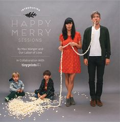 Cute holiday family photo! Love the idea of using the popcorn string. Maybe with a very large dog at one end ;)