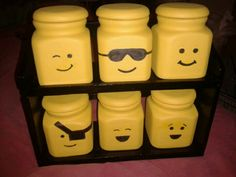 """LEGO storage heads made from an old spice rack set.  Paint, lightly draw face with a pencil.  Trace pencil markings with a paint or regular black sharpie.  Use """"dabbing or dotting"""" motions and avoid long strokes.  Spray with a clear coat to protect the conatiners.  Sgs"""