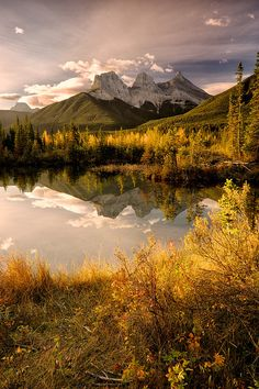 Three Sisters reflected in the lake near Canmore, Alberta, Canada