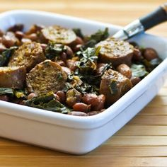 If you've got garden greens coming out of your ears, this easy Crockpot Recipe for Sausage, Beans, and Greens is a delicious way to use them. Make on the weekend and take to work for lunch! [from Kalyn's Kitchen] #CrockPot #SlowCooker #GardenGreens