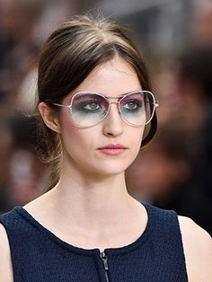 Colorful, up-to-the-brows eye makeup—paired with glasses—really stood out at the Chanel spring 2015 show