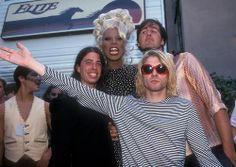 """September 2nd, 1993 - Nirvana, shown here with RuPaul, attends the MTV Video Music Awards in California, 1993. The band won 'Best Alternative Video' for their single, 'In Bloom.'  Nirvana stated after winning:  Dave Grohl: """"They tell you beforehand. I guess if anyone looks surprised when they receive their award.. We do a good job."""" Krist Novoselic: """"We are, after all, professionals."""" Kurt Cobain: """"Method acting."""""""