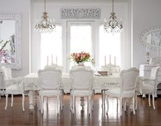 White romantic dining room with long dining table all in white!