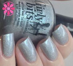 Girly Bits- Accidental PPV - A silver holo, with a turquoise flash and blue flakes. Cosmetic Sanctuary