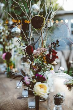 tall wildflower centerpieces, photo by Bethany Carlson http://ruffledblog.com/a-handcrafted-wedding-in-sunnydale #weddingcenterpieces #flowers