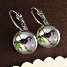 $7.00.  Love these from my favorite vendor.  I have a pair.The little bird is on a handmade photo glass cabochon. It sits on a silver plated brass cameo setting with lever back earring hooks.