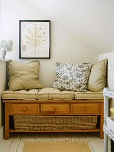 Convert a Coffee Table into a Bench. Just add the Pillows for comfort and a big basket or a few small ones underneath. Could also store blankets or quilts underneath instead of Baskets.