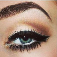 shimmery winged eyes + bold brows.