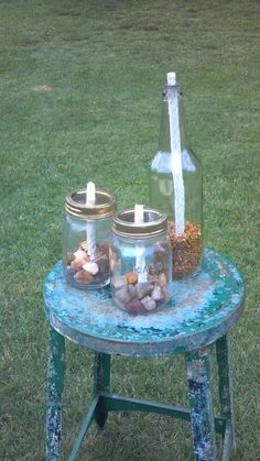 Make Tiki torches out of wine bottle's or old mason jars. Just use a washer on top of the bottle, and drill a hole in a mason lid. Fill bottom with rocks or sand and top with torch fuel!!