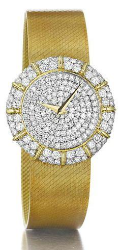 Chopard. A Diamond and Gold Lady's Wristwatch