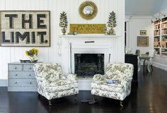 Old painted signs in Linda Banks living room by junkgarden, via Flickr