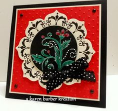 handmade card ... Daydream Medeallion cut with Floral Frames ... Black Magic Technique for the center: Stamp in white pigment ink, let dry on black cardstock then color with watercolor pencils.  Used two colors for the flower and two for the leaves....the darker color to shade after coloring lightly with the first and lighter color.  It really comes alive when you highlight with a white gel pen.   Stampin' Up!