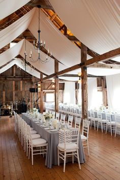 Barn Setting with Elegant Draping | See this Rustic Elegant wedding on SMP: http://www.StyleMePretty.com/new-england-weddings/2014/01/16/rustic-meets-modern-wedding-at-the-barn-at-walnut-hill/ Becca Wood Photography