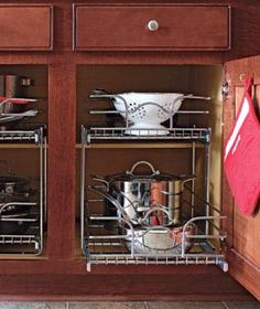 Organized storage is a must in a small kitchen. All of my lower cabinets have pull out shelving or drawers. These sliding shelf organizers are an affordable alternative to built-ins... Easy, peezey...