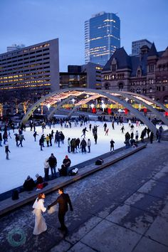 Skating downtown Toronto, if it has to be cold we might as well go skating :)