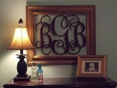 Add vinyl monogram to glass of a picture frame, hang without the back on the frame.