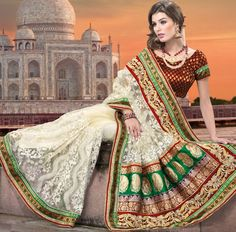 Take the fashion industry by storm in this beautiful embroidered saree.   This cream net saree is nicely designed with embroidered patch work is done with resham, zari, sequins, stone and lace work.   Beautiful embroidery work on saree make attractive to impress all.   This saree gives you a modern and different look in fabulous style.   Contrasting maroon blouse is available.   Slight color variations are possible due to differing screen and photograph resolution.
