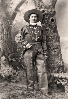 "Shown here with her six-gun on her hip, Martha ""Calamity Jane"" Canary found freedom to live an unconventional lifestyle when she masqueraded as a man and secured employment as a muleskinner. This hard-drinking woman found a home in Nicholas Kappes's beer saloon in Rock Springs, Wyoming. He recalled her days frequenting the rougher saloons in nearby Green River, playing with her gun and bragging aloud, ""When this dog barks, somebody drops!""  – Courtesy Heritage Auctions, May 21, 2011 –"