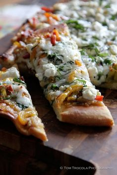 Delicious grilled pizza, homemade crust, peppers, basil, and goat cheese