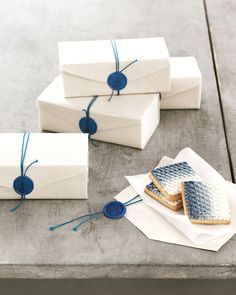 Present small items (like homemade cookies!) in canvas-wrapped paper boxes…