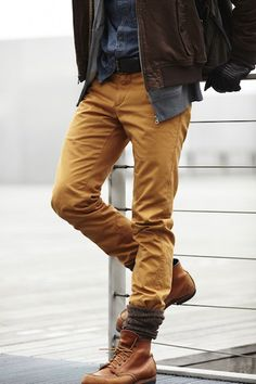 Mustard Chinos Tucked Into Thick Socks Peeking out of Tan Boots