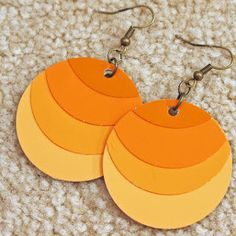 Ever wondered what you can do with your leftover paint chips? Try making DIY jewelry with these festive Ombre Paint Chip Earrings. These candy corn-colored earrings are perfect for fall, especially Halloween time.