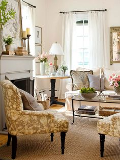 Fabulous Florals Delicate floral patterns throughout this living room give the space a pretty, vintage vibe. These upholstered chairs help draw the eye toward the striking fireplace and mantel display.