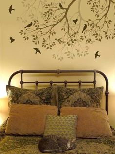 Beautiful wall stencil - and what every bed needs: a cat