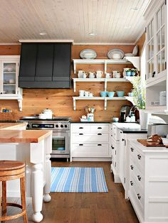 Vary Wood Finishes- paint the backboards or leave woodtone to warm up the white cabinets