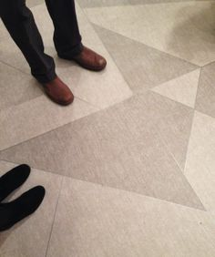 The crowd at Mannington Commercial's NeoCon 2014 cocktail party may have been staring at their feet, but it wasn't because they were shy! They were just admiring the Intersected graphic floor tiles, designed in collaboration with Corgan Associates. NeoCon 2014