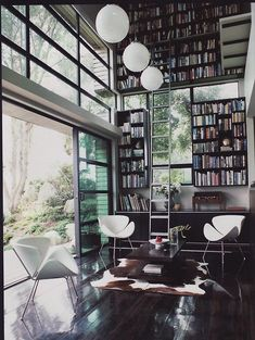 Book wall and dark floors