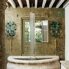 This bathroom reminds me of when we used to live in Italy.  Something from a Villa.  I found it when researching for Grotto type of bathrooms.