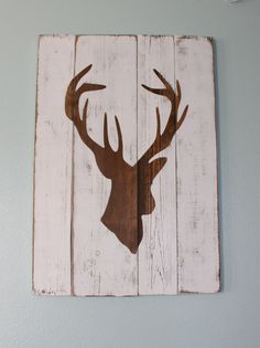 White Distressed Deer Head Silhouette Wood Sign. Maybe do with fishies or something for the cabin? wood signs, deer sign, deer pallet sign, deer head decor, deer heads, boy nurseries, white distress, deer head silhouette, silhouett wood