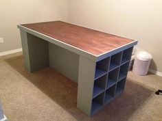 This craft table was built from a hollow core door (available at Our Towns Habitat ReStores!) and bookshelves. Easy to do and a great storage solution!