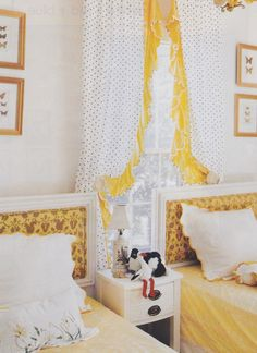 Pretty ruffled polka dot curtains and headboards in this room.  #polkadot #rufflecurtains #yellow