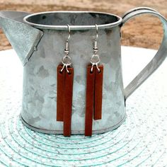 Brown Leather Bar Earrings- Lightweight and casual for everyday wear. Hand cut and crafted brown leather double bar earrings made with lead and nickel free silver plated brass. Approx. 2 in length. Available with antiqued brass hardware, silver plated brass hardware (pictured),