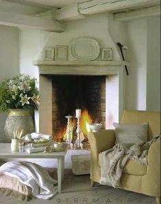 cozy corner fireplace, with ironstone on mantel...
