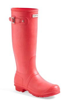 Bright coral Hunter boots for puddle jumping!
