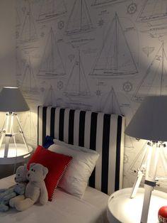 boy's bedroom with sailboat wallpaper, navy & white striped headboard & pops of orange. #nautical #bedroom #wallpaper