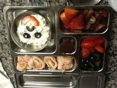 Olives, Tomatoes, grapes, strawberries, sandwich roll-up, fruit leather hearts, and a cottage cheese smiley face :)