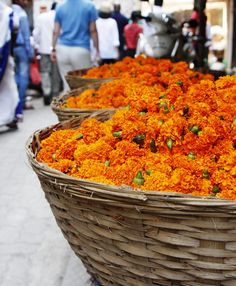 Vivid marigolds aplenty entice from woven baskets in Mumbai, India.